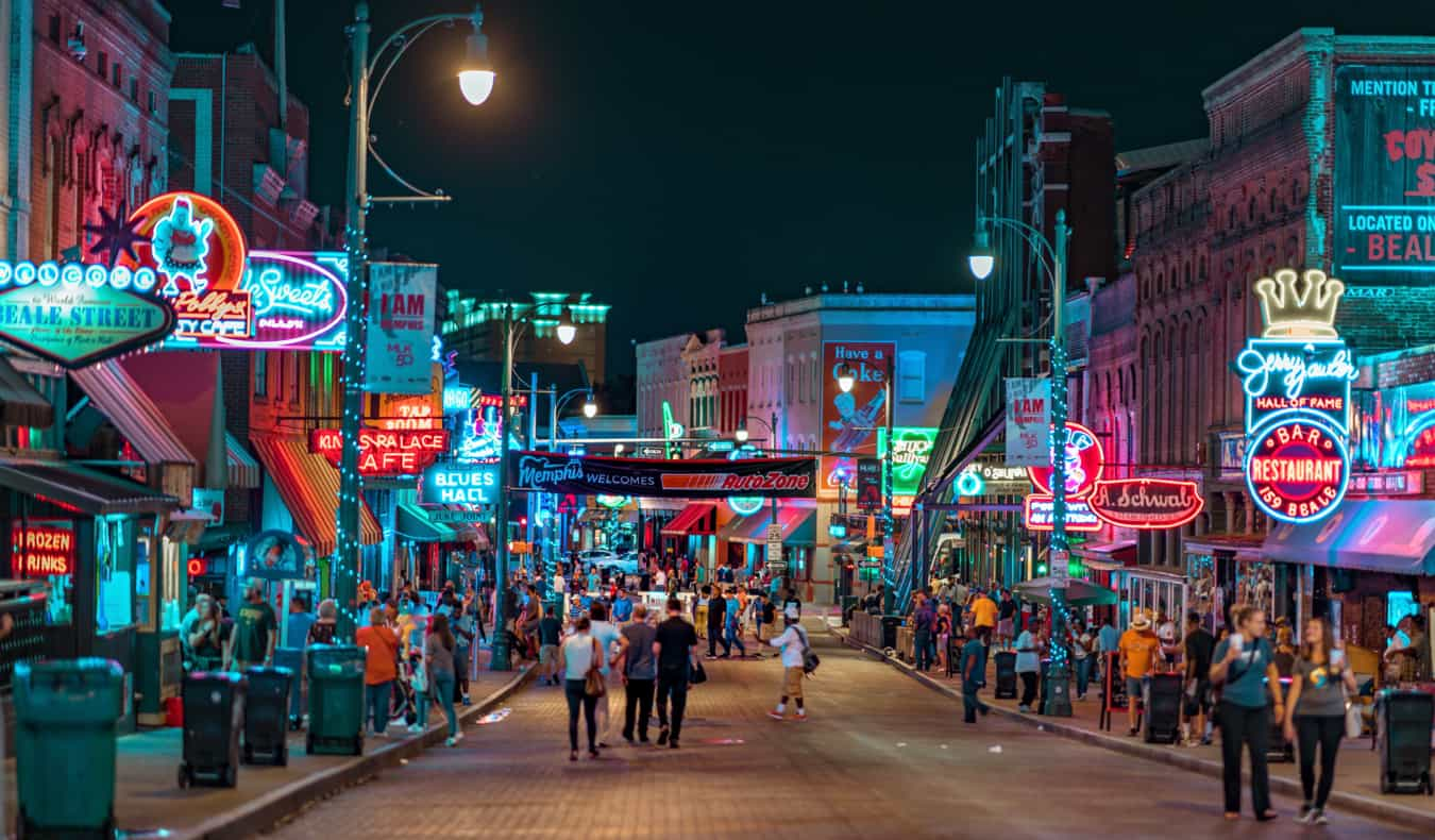 The bustling downtown core of Memphis, TN at night full of tourists and locals