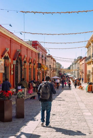 People exploring the historic center of Oaxaca, Mexico