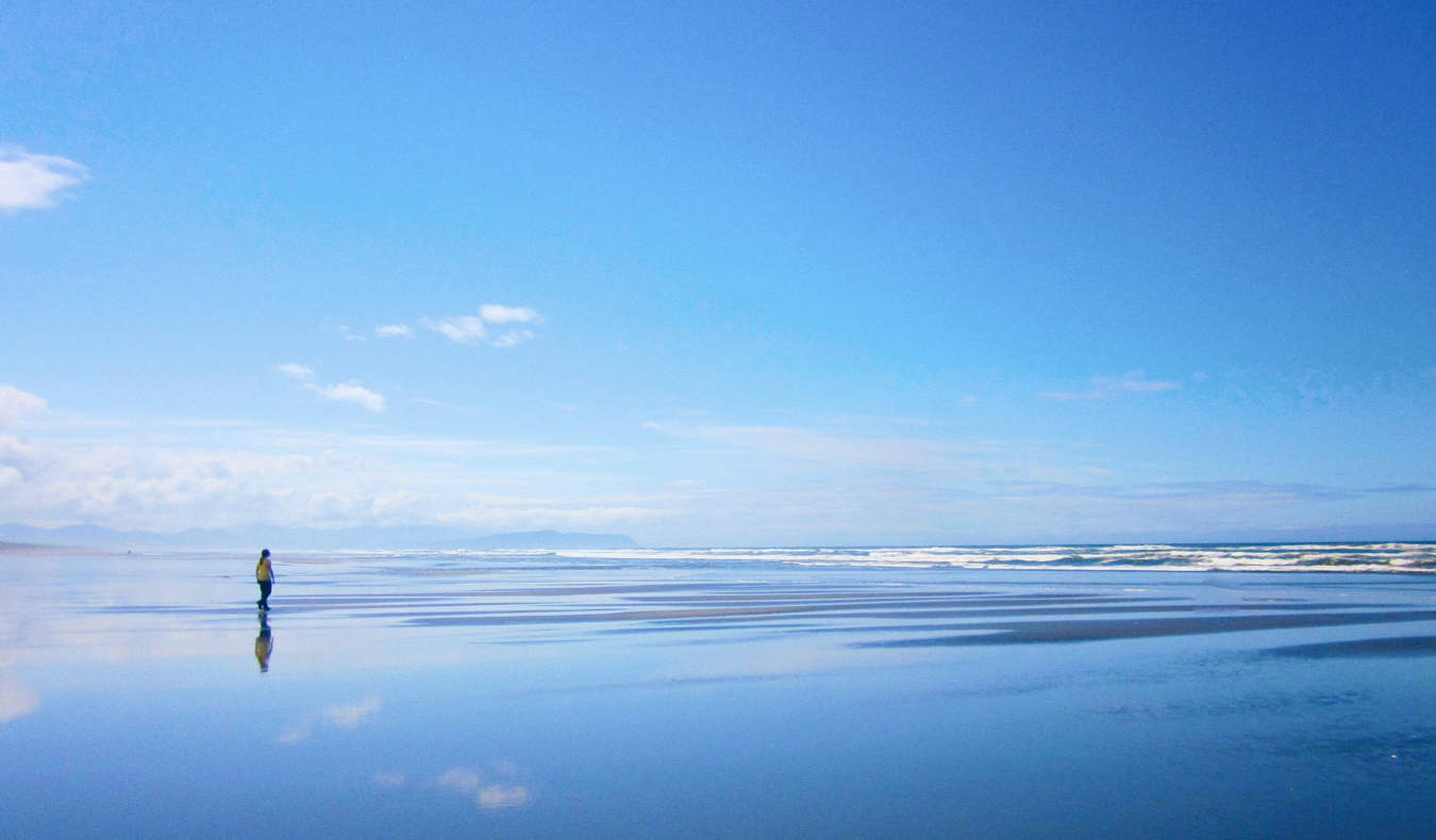 A lone woman on Seaside beach in Oregon, USA