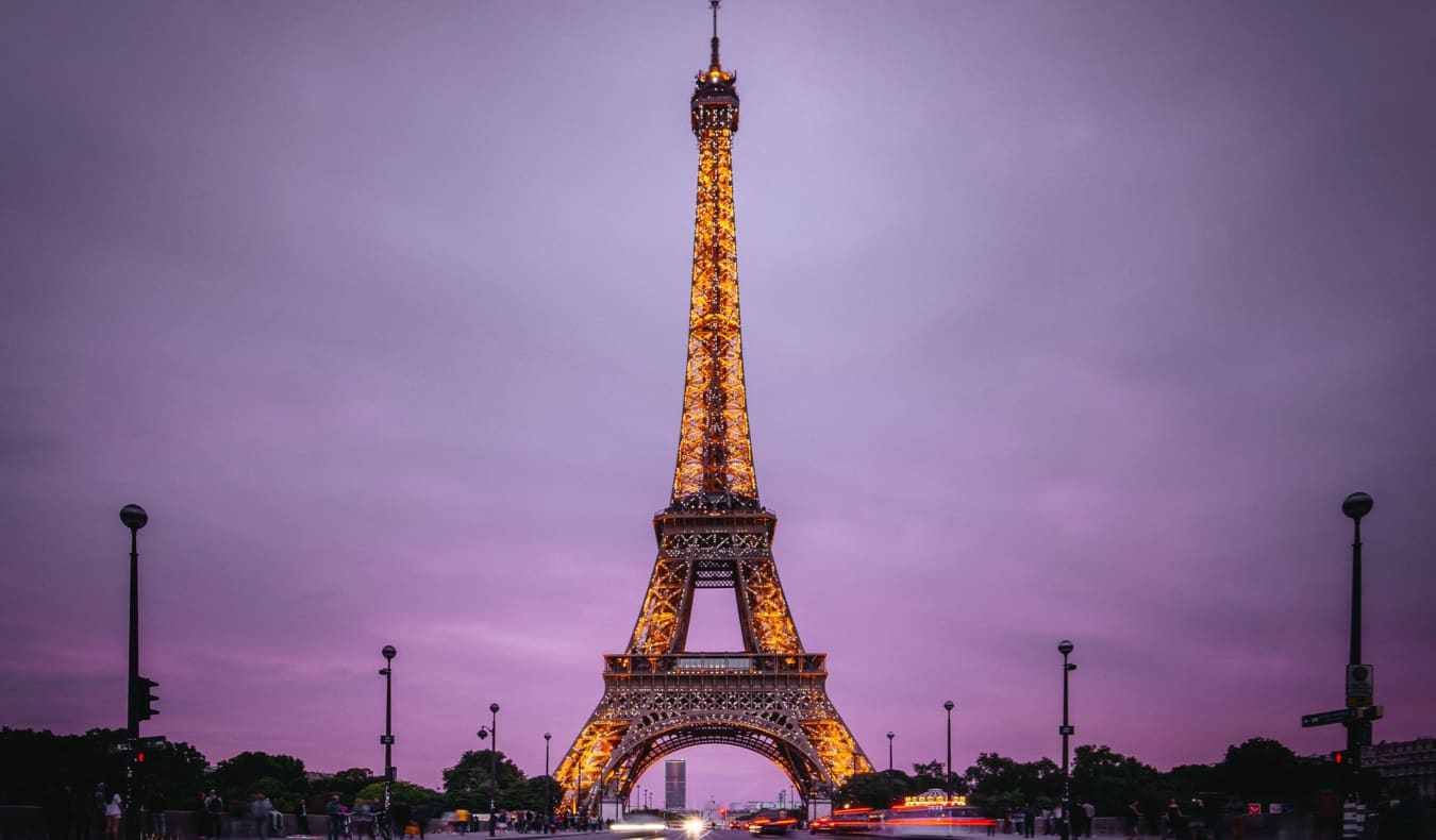 Eiffel Tower lit up at night in Paris