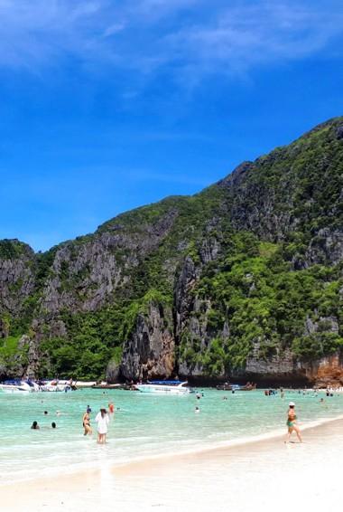 People enjoying the popular beach at Maya Bay on Ko Phi Phi