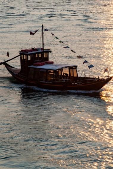 A lone boat on the river in Porto, Portugal