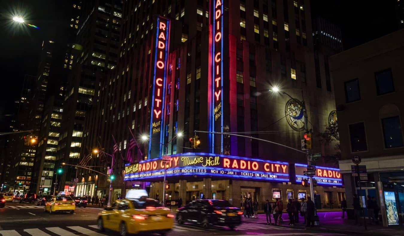 Radio City Music Hall lit up at night in NYC