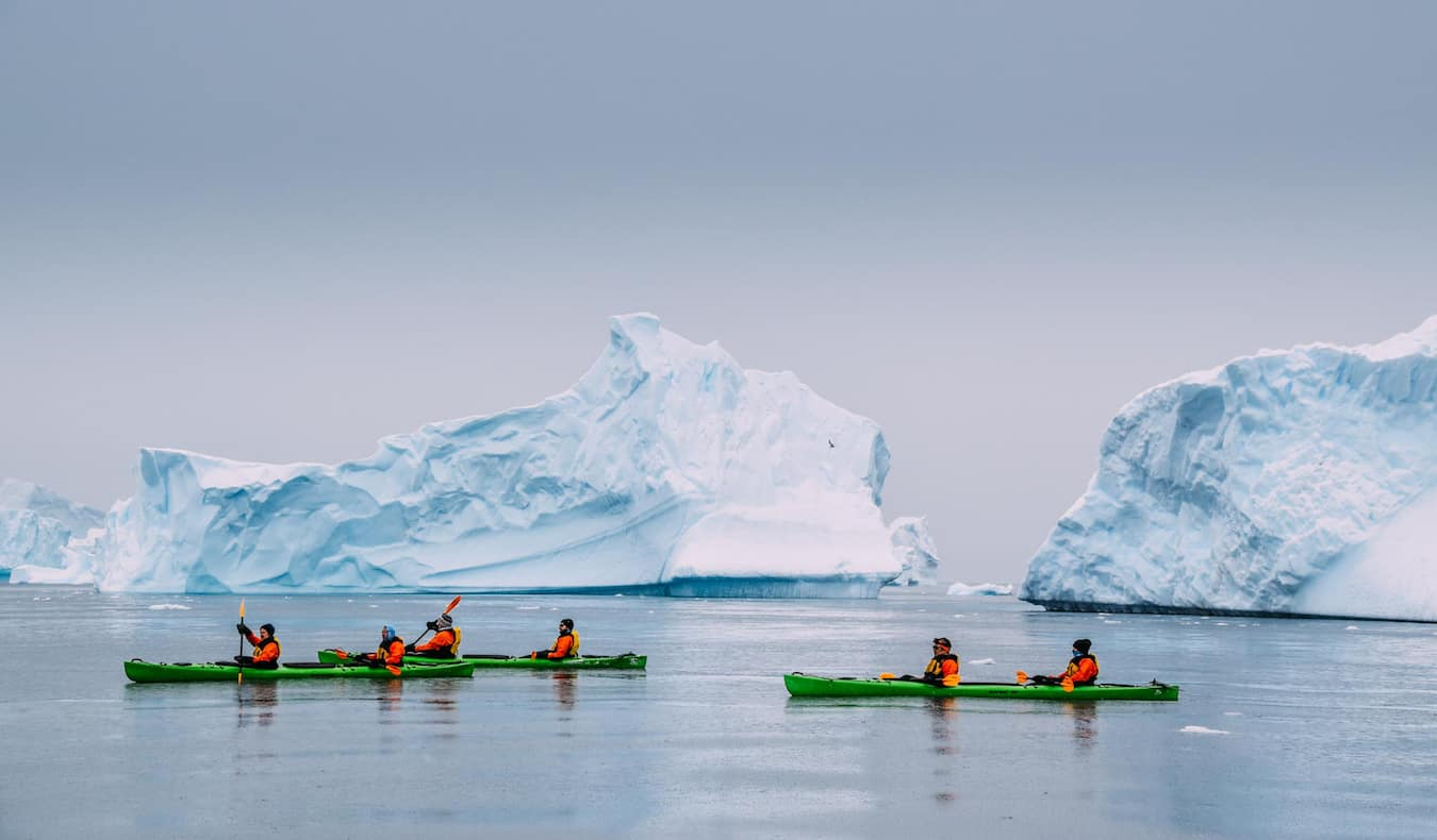 Rax, a solo digital nomad, kayaking in Iceland