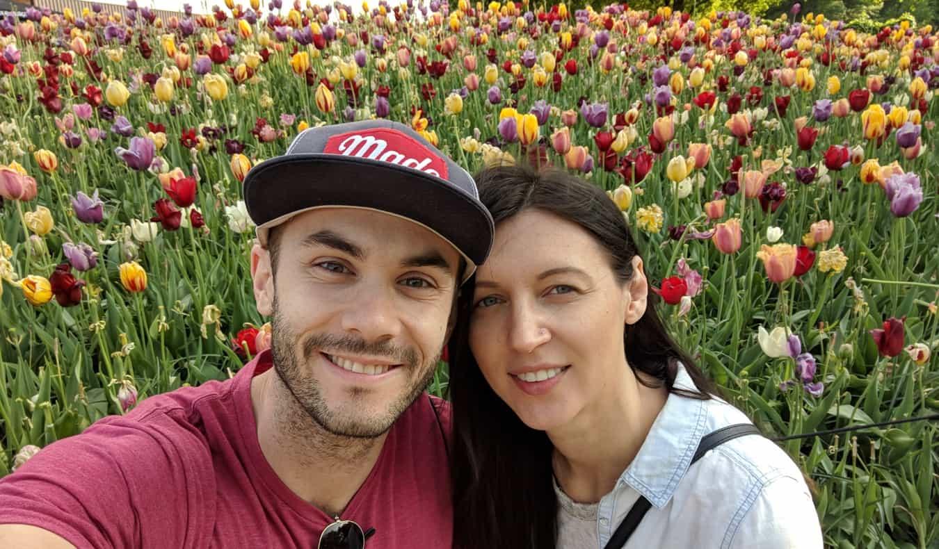Scott Keyes from Scott's Cheap Flights in a field of flowers