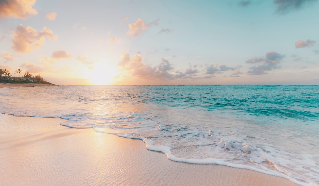 A clear, empty beach at sunset in Hawaii, USA