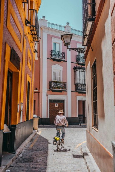 A man riding his bicycle in Seville, Spain
