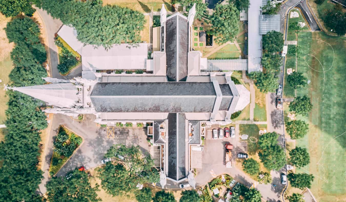 A drone shot of Saint Andrew's Cathedral in Singapore