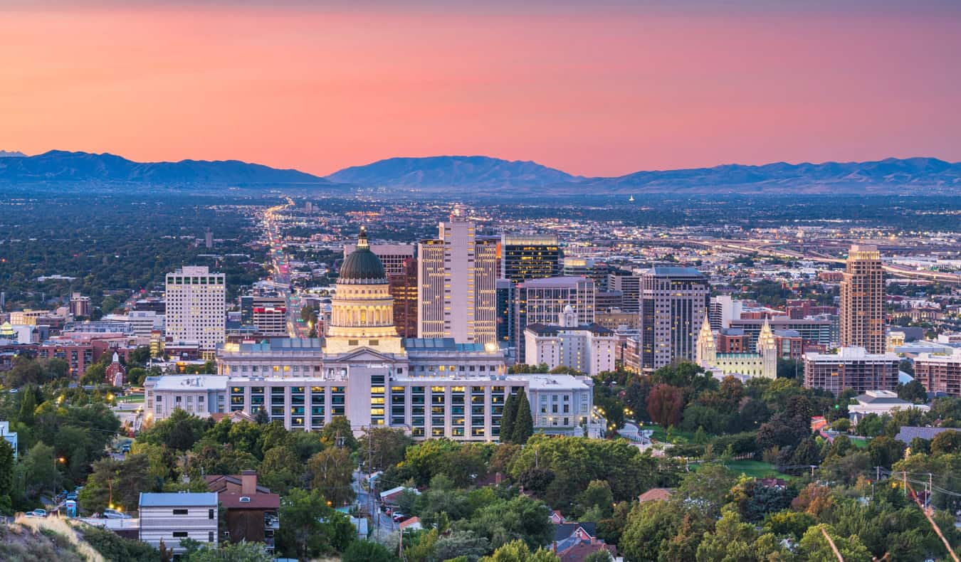 A colorful sunset over Salt Lake City, Utah with mountains in the background