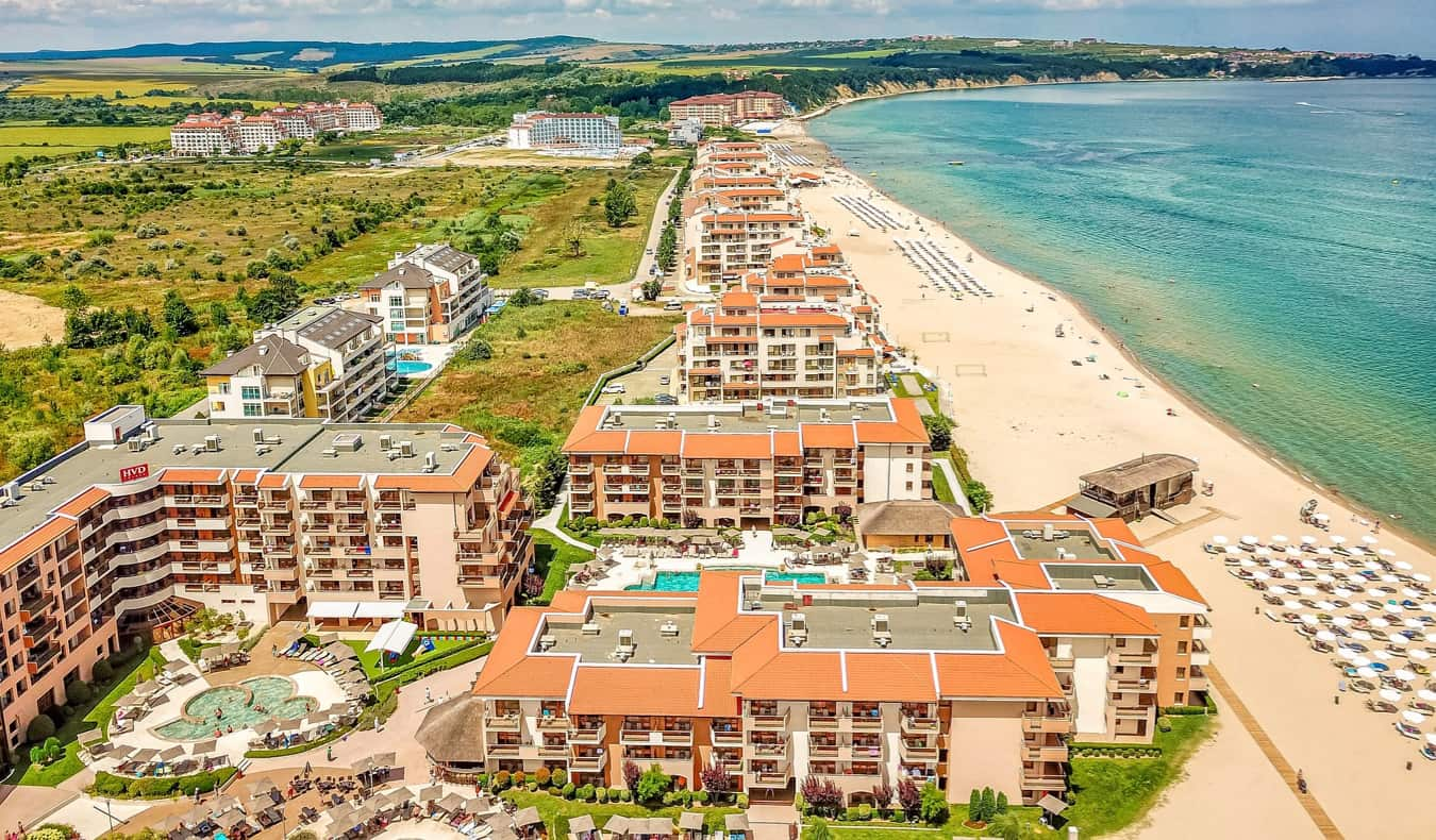 The crowded beach and waters of Sunny Beach in Bulgaria on a bright summer day