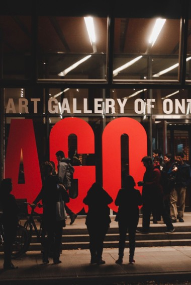 The exterior of the AGO at night in Toronto, Canada