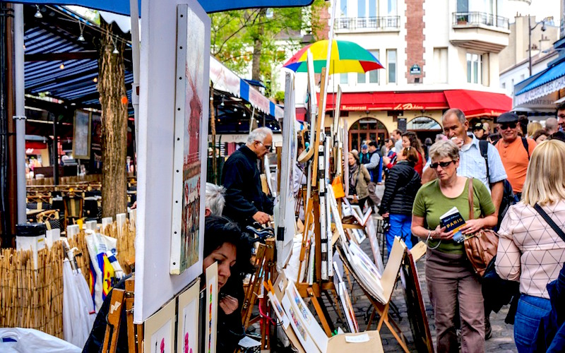 people browsing art in the montmartre district