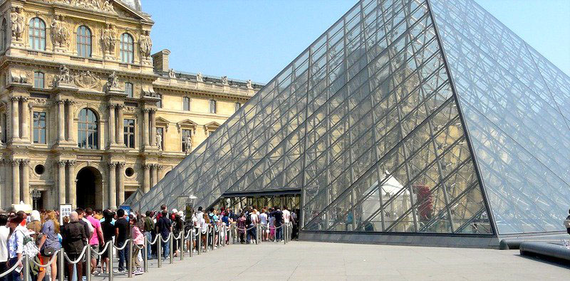 people waiting to get into the louvre museum