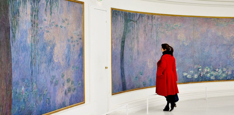 a woman admiring art at Musée de l'Orangerie, photo by Adrian Scottow (flickr: chowhound)