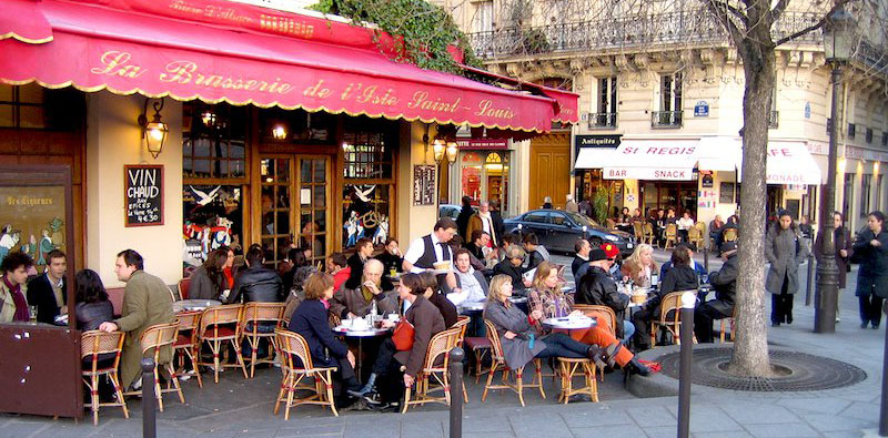 people relaxing at a cafe, photo by Pat Guiney (flickr: mrmystery)