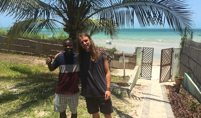 Two travelers posing for a photo in Tofo, Mozambique
