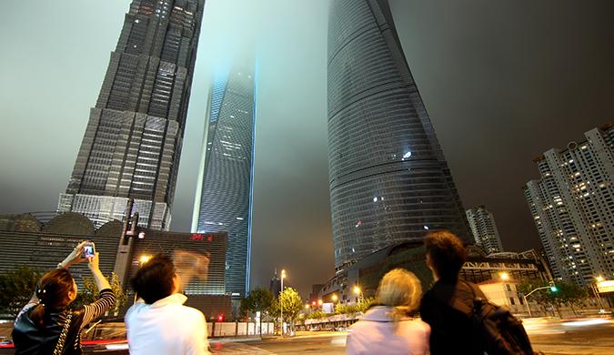 Expats staring at the towering skyline at night in China