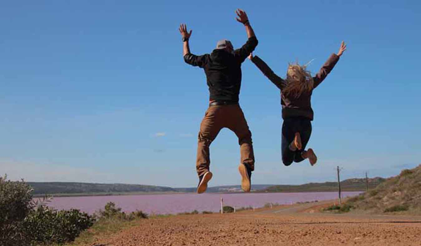 people jumping on a road trip in Australia