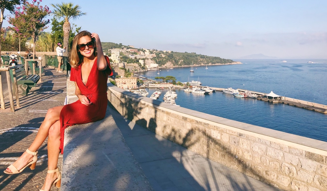 woman traveler italian style founder on A day trip to Sorrento red dress
