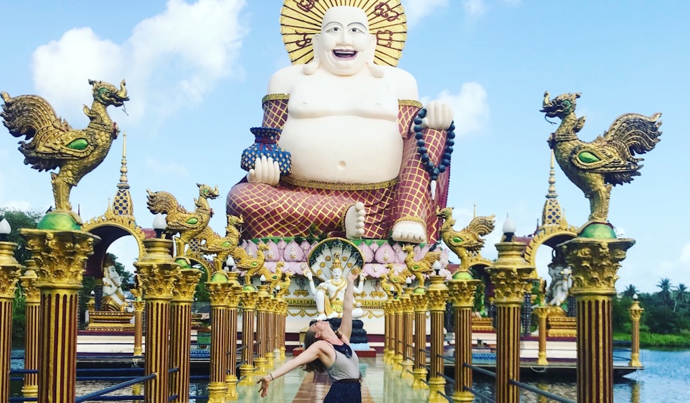travel community member adrien posing outside of a temple in asia
