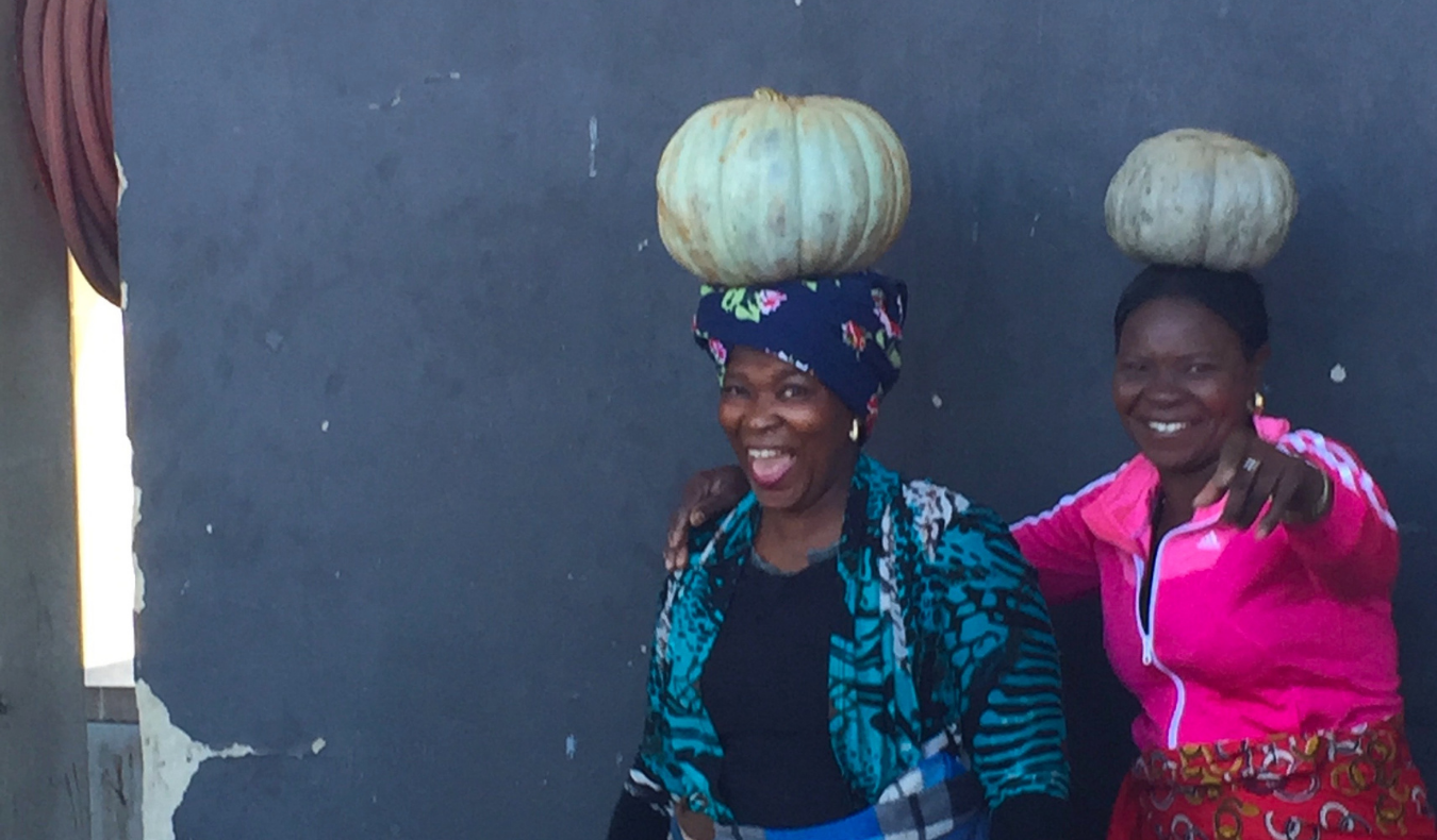 women holding pumpkins on their heads in South Africa