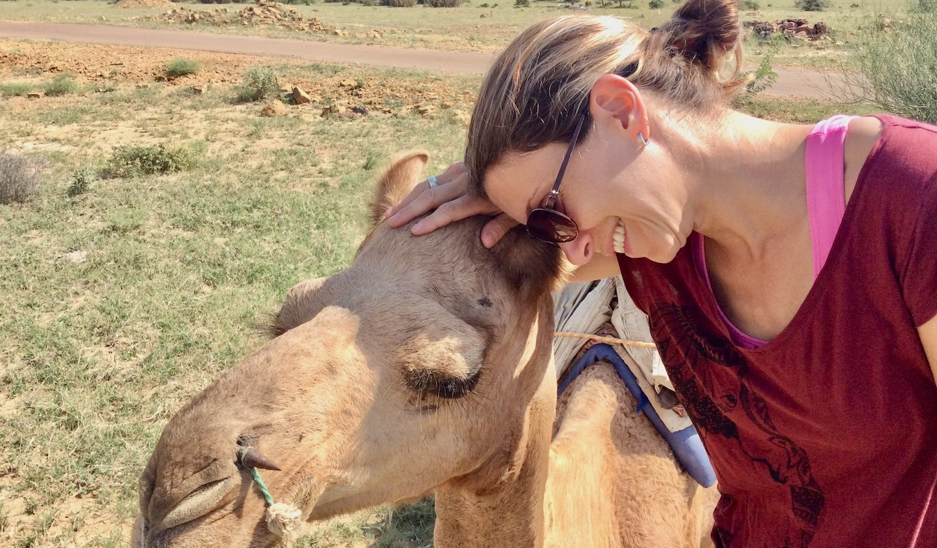 travel community member catalina with a camel smiling