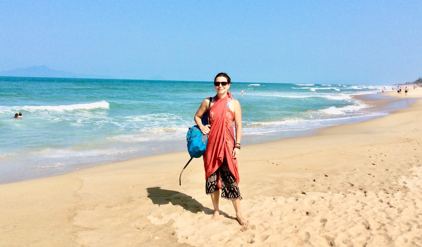 woman traveler on beach in sarong