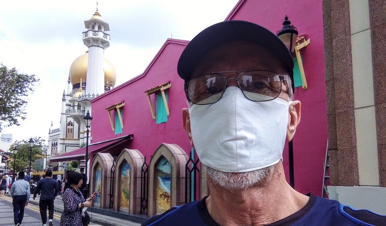 podcaster travel community member david bishop smiling through a mask covid19d