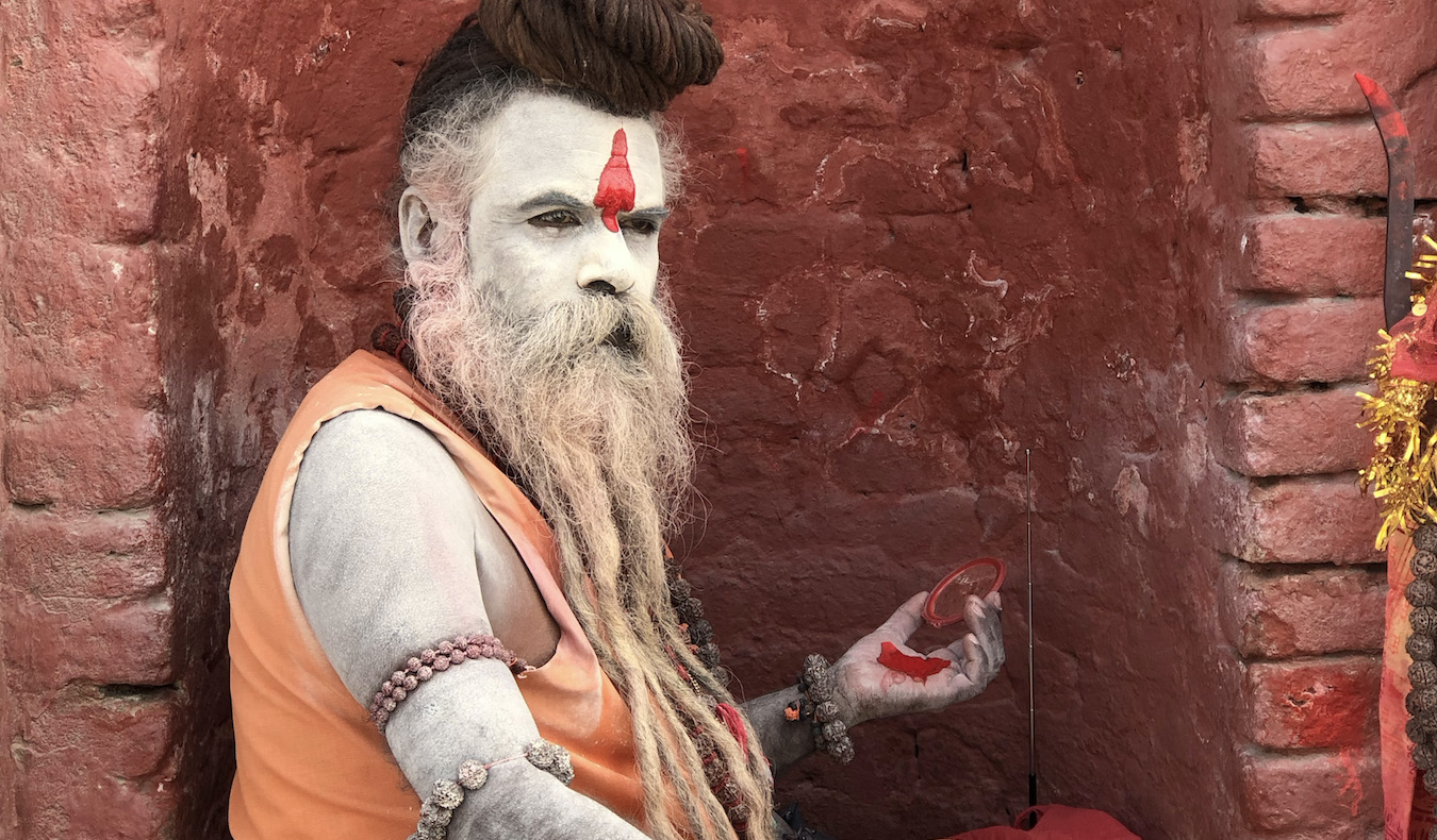 man painted face with makeup in nepal