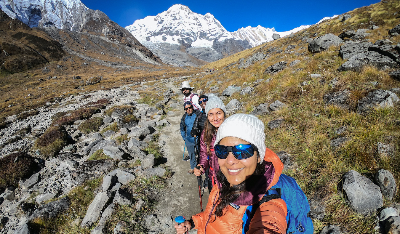 a group of hikers trekking to Annapurna basecamp in Nepal