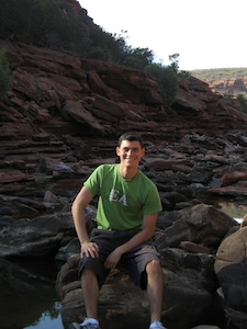 Nomadic Matt sitting on a rock in Australia