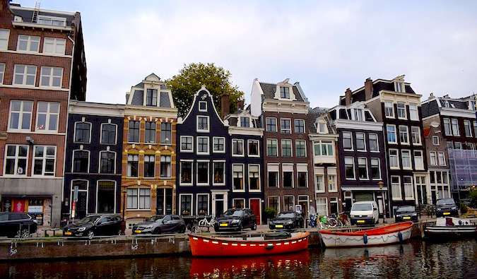 Boats and buildings near the canal in the city of Amsterdam, Holland