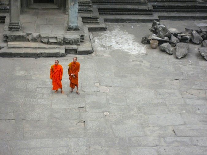 Two monks in orange robes at Angkor Wat, Cambodia