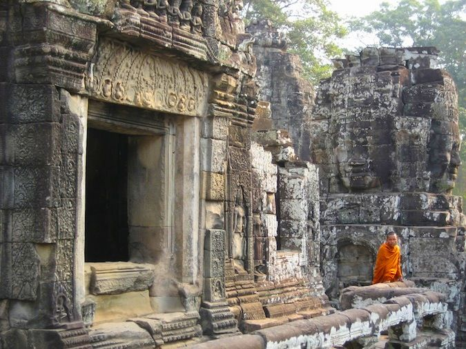 A monk gazes out onto the ruins