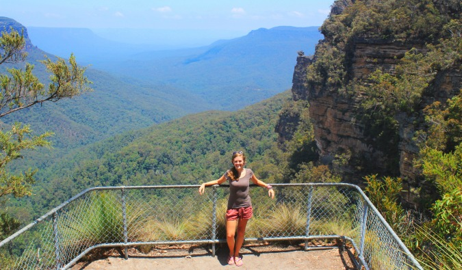 Female Lauren standing in front of lush Australian landscape