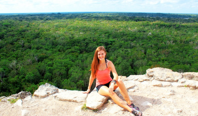 Solo girl traveler hikes to the top of a mountain in Mexico