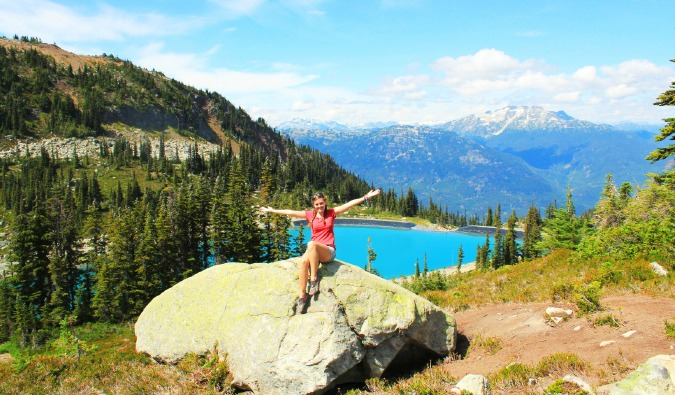 Backpacking around Canada and visiting the lush landscape and lake in Whistler