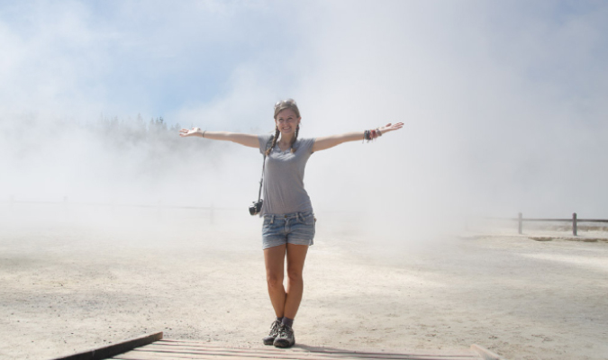 Solo girl traveler in a sand storm in New Zealand