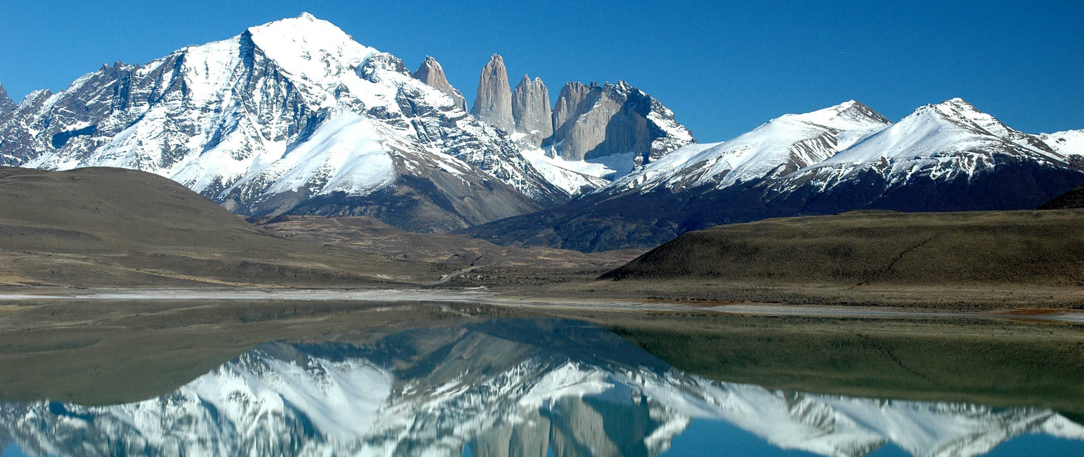 the mountains in Patagonia under a pristine blue sky