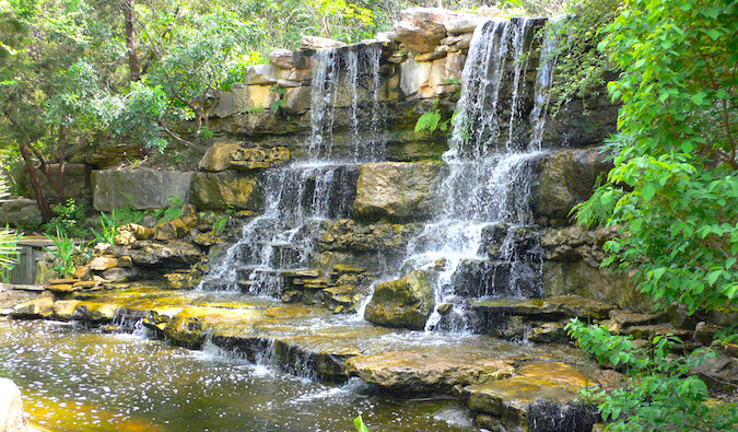 Gardens and a waterfall in Zilker Park in Austin
