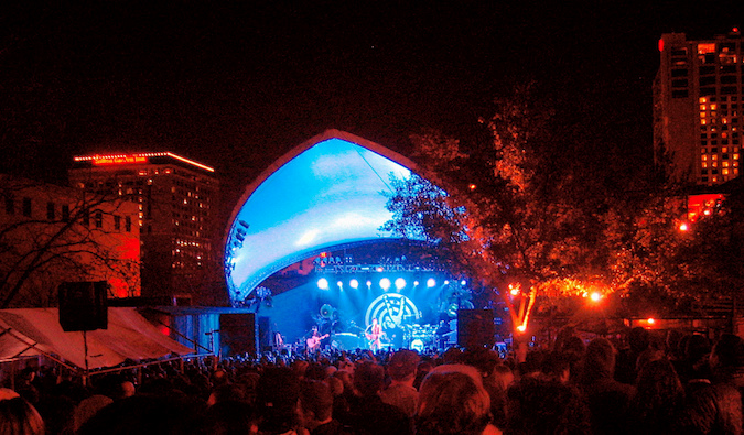 A huge outdoor crowd enjoying music at Stubb's bar in Austin, Texas