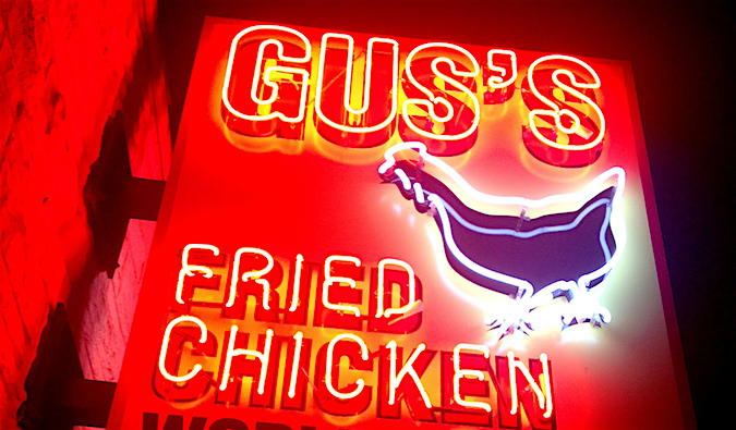 A neon sign for Gus' World Famous Fried Chicken