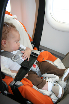 baby sleeping on a plane