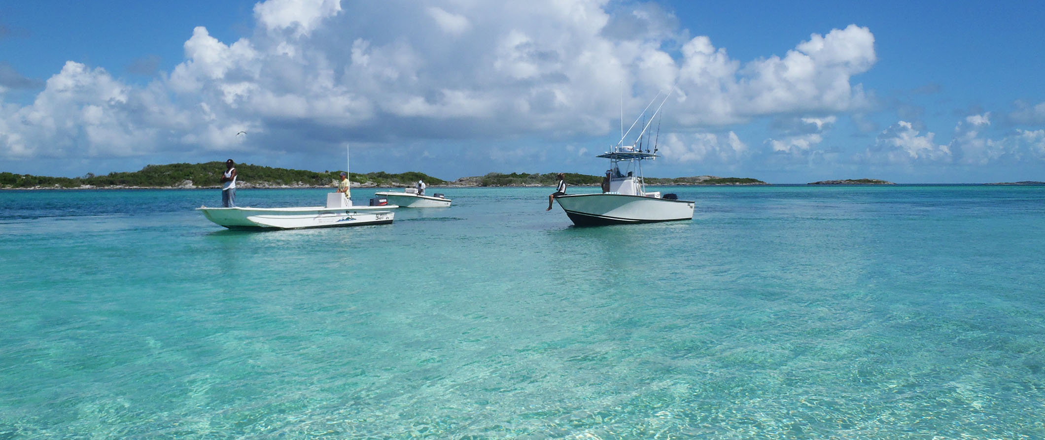 people fishing off boats in the bahamas