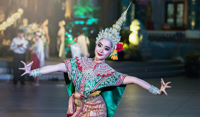a Balinese dancer posing for a photo