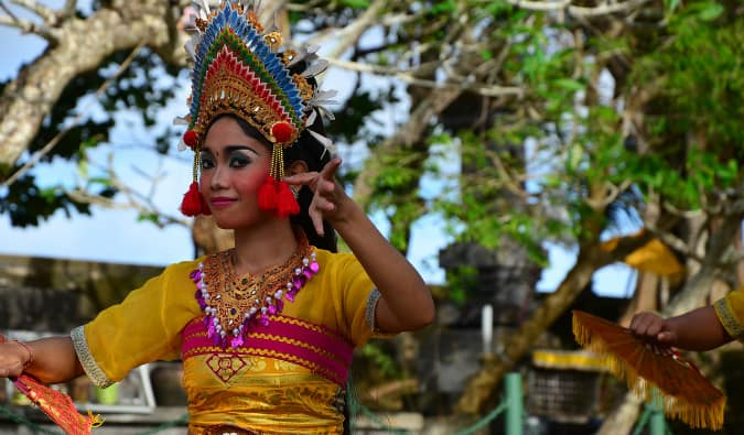 A traditional Bali dancer smiling for the camera