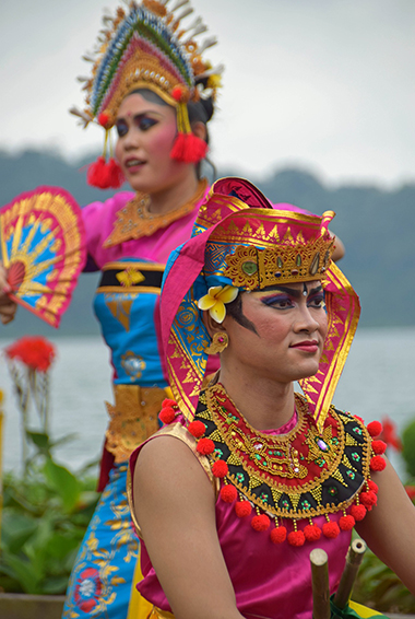 two Balinese dancers in full costume