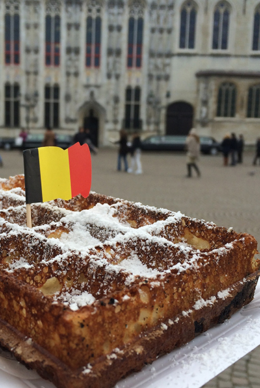 Belgian waffle with a Belgian flag on a toothpick