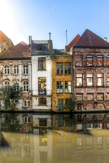 bright buildings along the water in Ghent