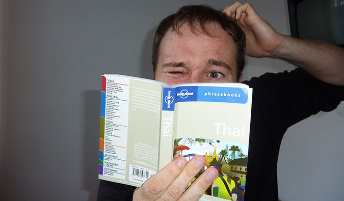 Benny studying a Thai phrasebook